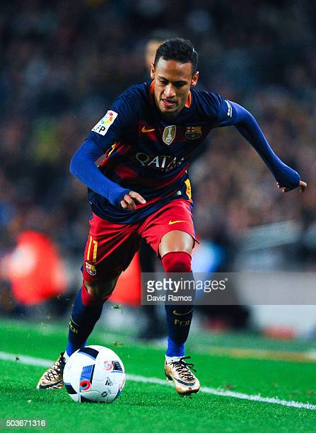 Neymar of FC Barcelona runs with the ball during the Copa del Rey Round of 16 first leg match between FC Barcelona and RCD Espanyol at Camp Nou on...