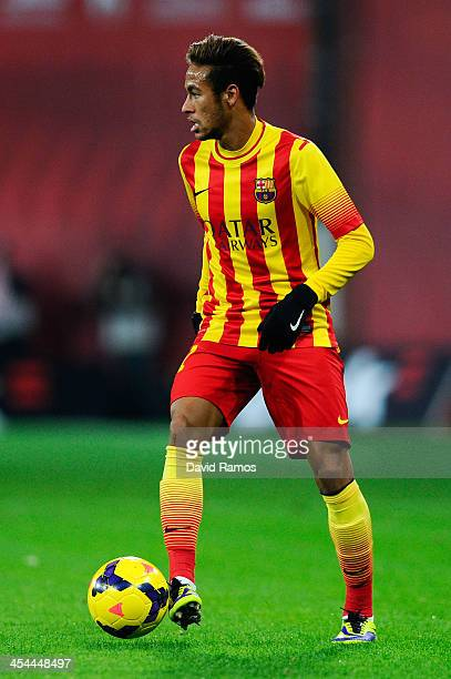 Neymar of FC Barcelona runs with the ball during the La Liga match between Athletic Club and FC Barcelona at San Mames Stadium on December 1 2013 in...