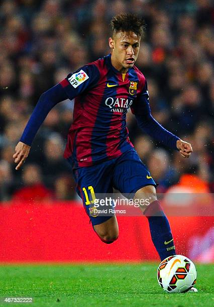 Neymar of FC Barcelona runs with the ball during the La Liga match Between FC Barcelona and Real Madrid CF at Camp Nou on March 22 2015 in Barcelona...