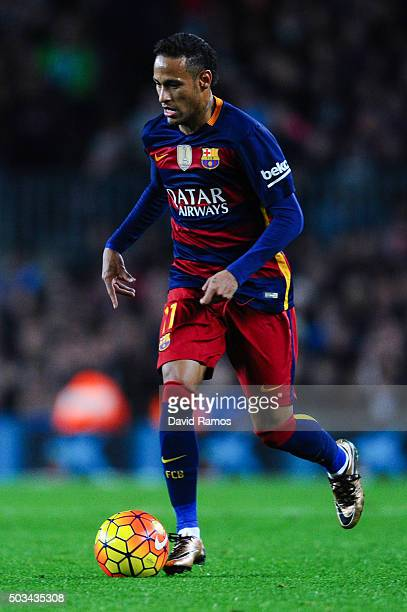 Neymar of FC Barcelona runs with the ball during the La Liga match between FC Barcelona and Real Betis Balompie at Camp Nou on December 30 2015 in...