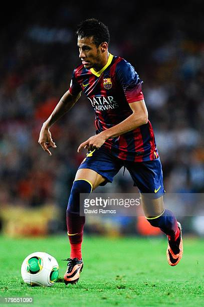 Neymar of FC Barcelona runs with the ball during the Spanish Super Cup second leg match between FC Barcelona and Atletico de Madrid at Nou Camp on...