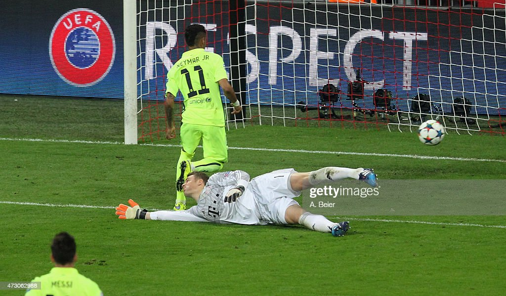 Neymar (top) of FC Barcelona scores his first goal against goalkeeper Manuel Neuer of Bayern Muenchen during the UEFA Champions League semi final second leg match between FC Bayern Muenchen and FC Barcelona at Allianz Arena on May 12, 2015 in Munich, Germany.