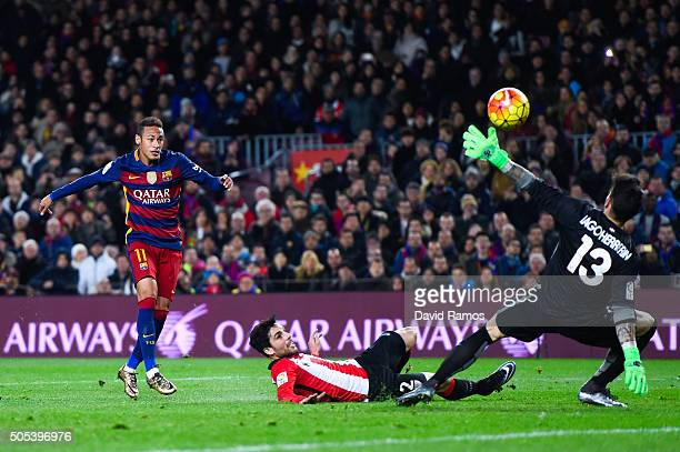 Neymar of FC Barcelona scores his team's second goal past Eneko Boveda and Iago Herrerin of Athletic Club the La Liga match between FC Barcelona and...