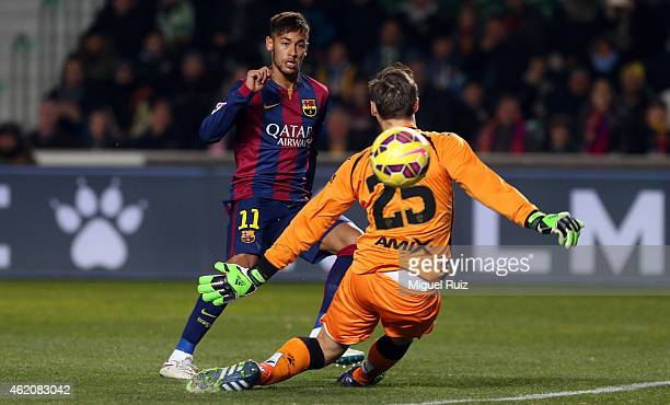 Neymar of FC Barcelona scores the third goal during the La Liga match between Elche FC and FC Barcelona at Estadio Manuel Martinez Valero on January...