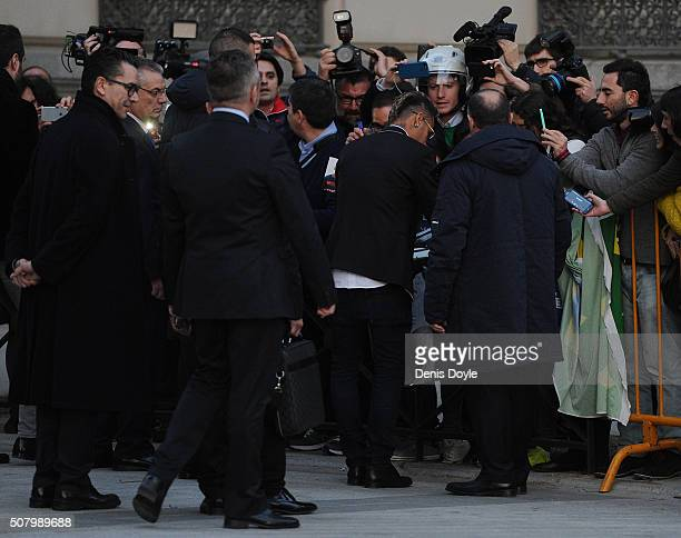 Neymar of FC Barcelona signs autographs after leaving the National Court on February 2 2016 in Madrid Spain Neymar was giving evidence over...