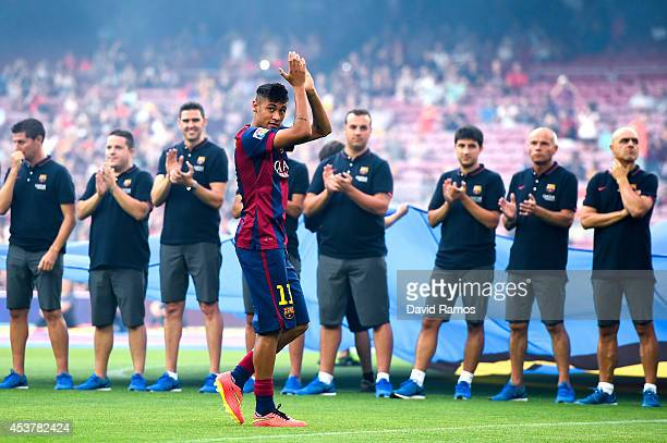 Neymar of FC Barcelona waves during the official presentation of the FC Barcelona prior to the Joan Gamper Trophy match between FC Barcelona and Club...