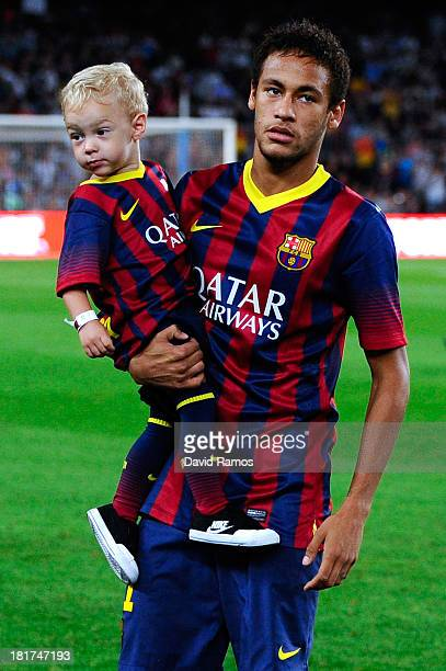 Neymar of FC Barcelona with his son davi Lucca walk out the pitch prior to the La Liga match between FC Barcelona and Real Sociedad de Futbol at Camp...