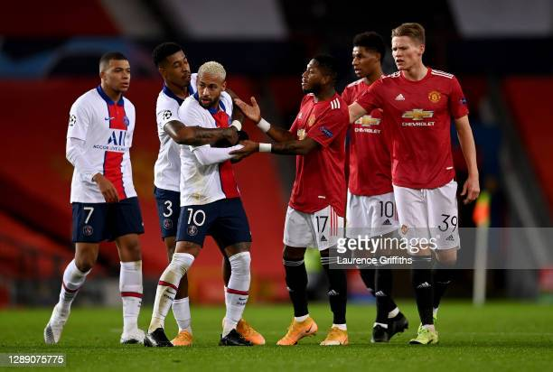 Neymar of Paris Saint Germain is held back by Presnel Kimpembe of Paris Saint Germain after clashing with Fred of Manchester United during the UEFA...