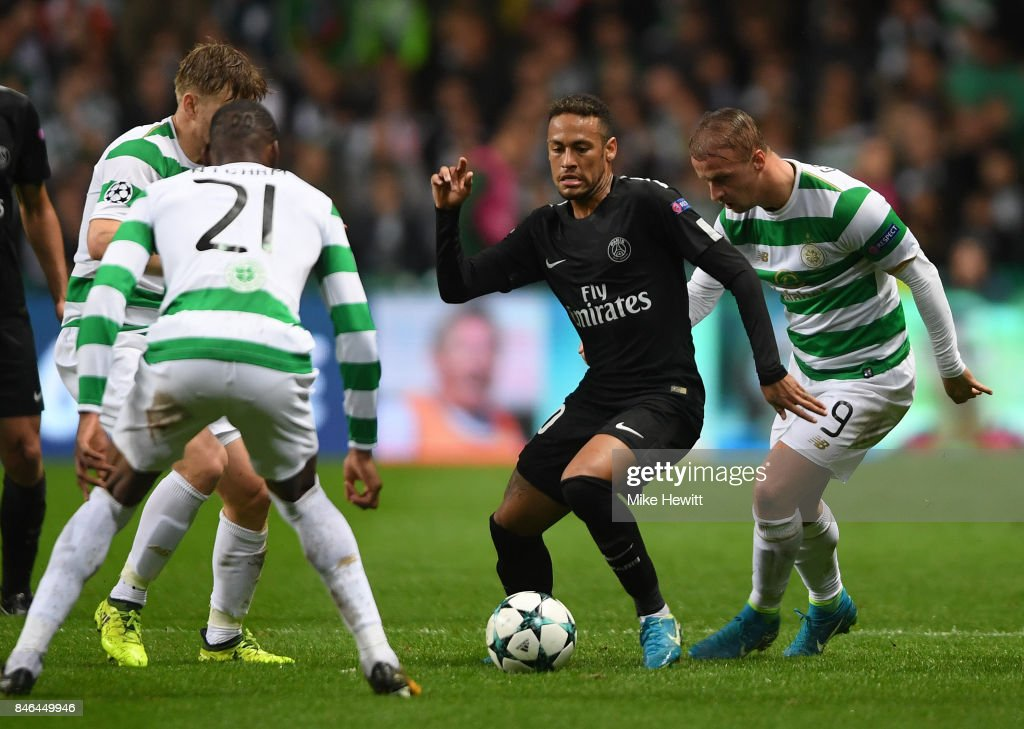Neymar of Paris Saint Germain is surrounded by Olivier Ntcham (21), Stuart Armstrong and Leigh Griffiths (9) of Celtic during the UEFA Champions League Group B match between Celtic and Paris Saint Germain at Celtic Park on September 12, 2017 in Glasgow, Scotland.