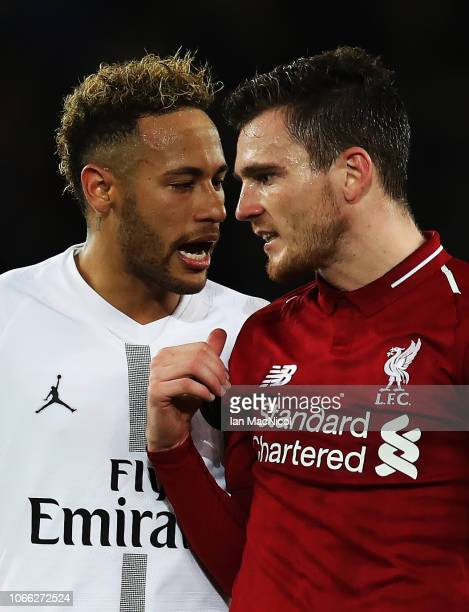 Neymar of Paris SaintGermain and Andrew Robertson of Liverpool disscuss a penalty award during the Group C match of the UEFA Champions League between...