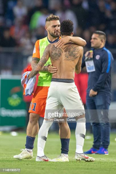 Neymar of Paris SaintGermain and Andy Delort of Montpellier embrace at the end of the game during the Montpellier Vs Paris SaintGermain French Ligue...