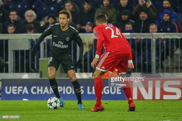 Neymar of Paris SaintGermain and Corentin Tolisso of Bayern Muenchen battle for the ball during the UEFA Champions League group B match between...