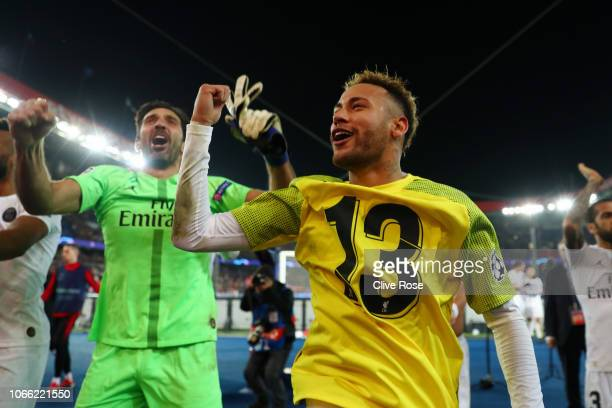 Neymar of Paris SaintGermain and Gianluigi Buffon of Paris SaintGermain celebrate victory following the UEFA Champions League Group C match between...