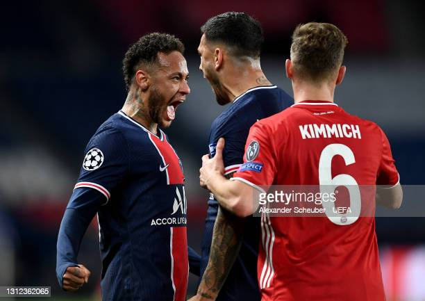 Neymar of Paris Saint-Germain and teammate Leandro Paredes celebrate their team's victory at full-time after the UEFA Champions League Quarter Final...