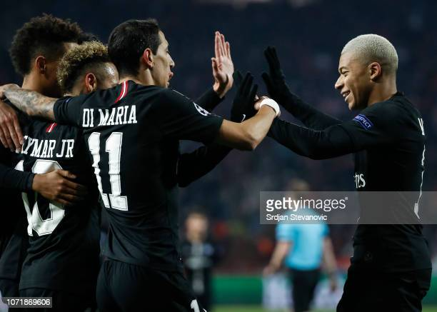 Neymar of Paris SaintGermain celebrates after scoring a goal with Angel Di Maria and Kylian Mbappe during the UEFA Champions League Group C match...