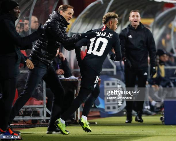 Neymar of Paris SaintGermain celebrates after scoring a goal with head coach Thomas Tuchel during the UEFA Champions League Group C match between Red...