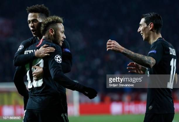 Neymar of Paris SaintGermain celebrates after scoring a goal with Thilo Kehrer and Angel Di Maria during the UEFA Champions League Group C match...