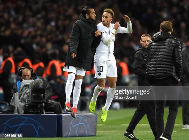 Neymar of Paris SaintGermain celebrates with Dani Alves of Paris SaintGermain after he scores his sides second goal during the UEFA Champions League...