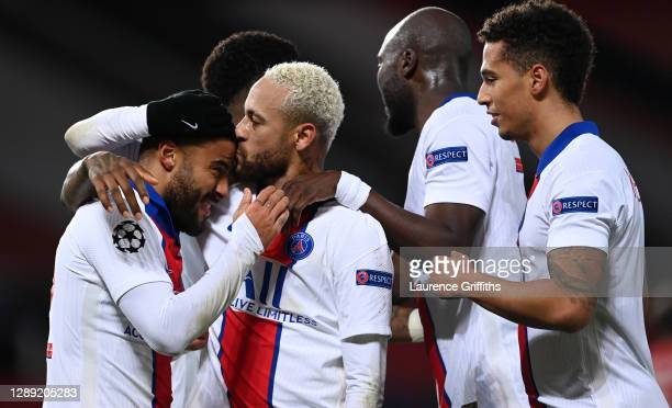 Neymar of Paris Saint-Germain celebrates with team mate Rafinha after scoring their sides third goal during the UEFA Champions League Group H stage...