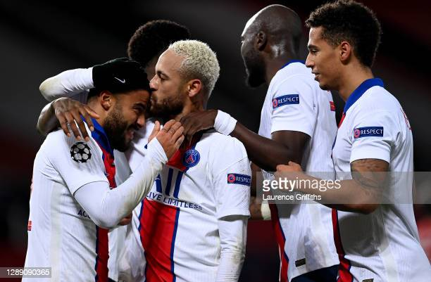 Neymar of Paris Saint-Germain celebrates with team mates Rafinha after scoring their sides third goal during the UEFA Champions League Group H stage...