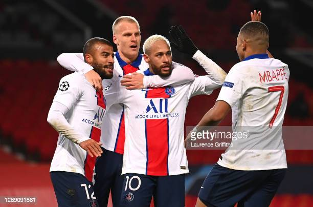 Neymar of Paris Saint-Germain celebrates with team mates Rafinha ,Mitchel Bakker and Kylian Mbappe after scoring their sides third goal during the...