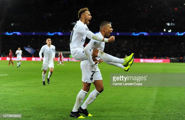 Neymar of Paris SaintGermain celebrates with teammate Kylian Mbappe after scoring his team's second goal during the Group C match of the UEFA...