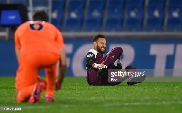 Neymar of Paris SaintGermain goes down injured during the UEFA Champions League Group H stage match between Istanbul Basaksehir and Paris...