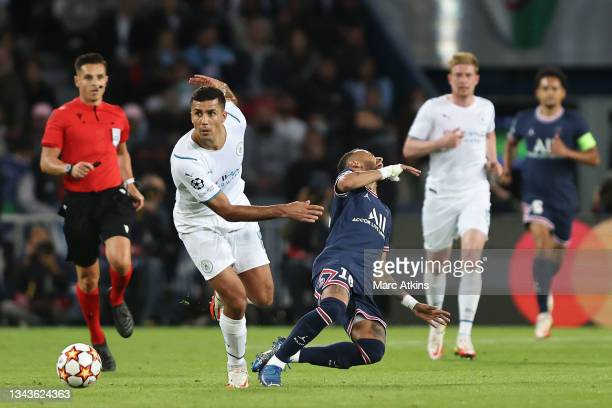 Neymar of Paris Saint-Germain goes to ground after a challenge from Rodrigo of Manchester City during the UEFA Champions League group A match between...