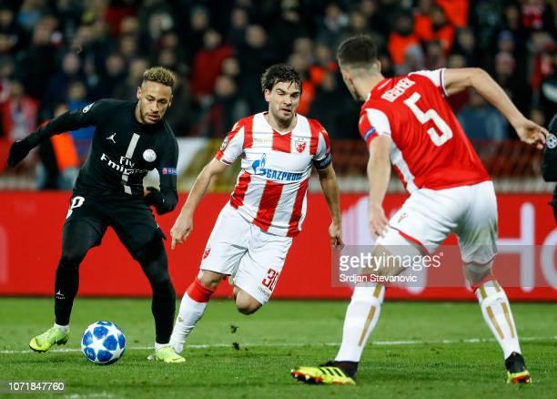 Neymar of Paris SaintGermain in action against Filip Stojkovic and Milos Degenek of Red Star Belgrade during the UEFA Champions League Group C match...