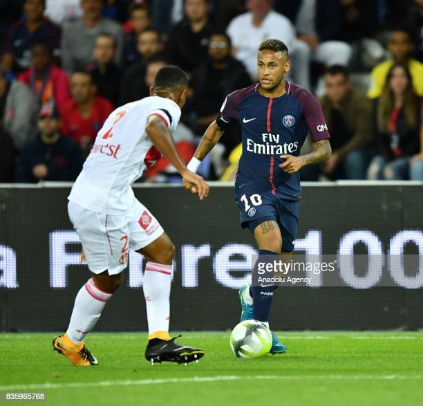 Neymar of Paris SaintGermain in action against Kelvin Amian of Toulouse FC during the French Ligue 1 soccer match between Paris SaintGermain and...