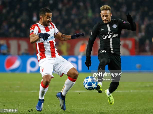 Neymar of Paris SaintGermain in action against Lorenzo Ebecilio of Red Star Belgrade during the UEFA Champions League Group C match between Red Star...