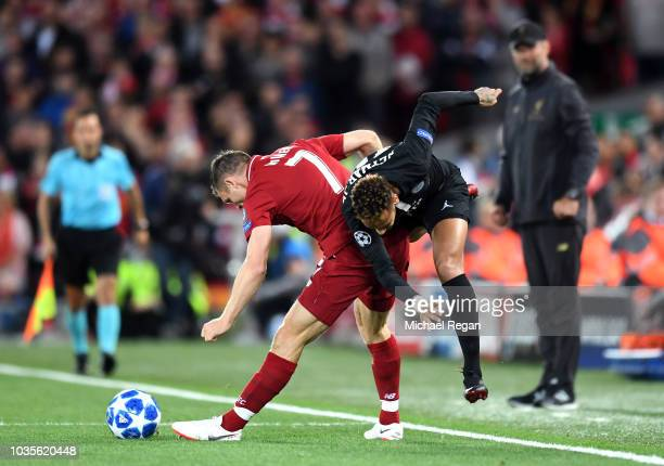 Neymar of Paris Saint-Germain is challanged by James Milner of Liverpool during the Group C match of the UEFA Champions League between Liverpool and...