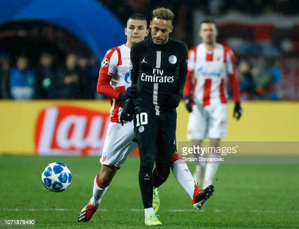 Neymar of Paris SaintGermain is challenged by Dejan Joveljic of Red Star Belgrade during the UEFA Champions League Group C match between Red Star...