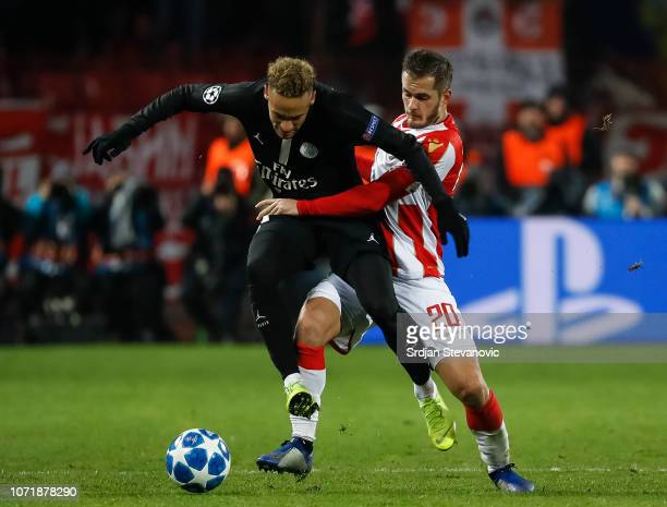 Neymar of Paris SaintGermain is challenged by Goran Causic of Red Star Belgrade during the UEFA Champions League Group C match between Red Star...