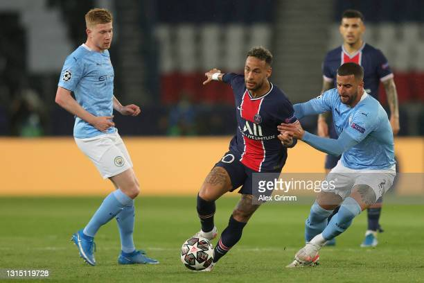 Neymar of Paris Saint-Germain is challenged by Kyle Walker and Kevin de Bruyne of Manchester City the ball during the UEFA Champions League Semi...