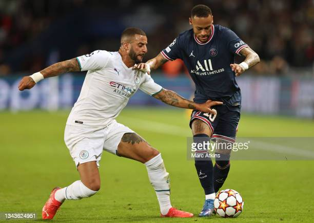 Neymar of Paris Saint-Germain is challenged by Kyle Walker of Manchester City during the UEFA Champions League group A match between Paris...