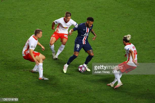 Neymar of Paris Saint-Germain is challenged by Lukas Klostermann, Dani Olmo and Kevin Kampl of RB Leipzig during the UEFA Champions League Semi Final...