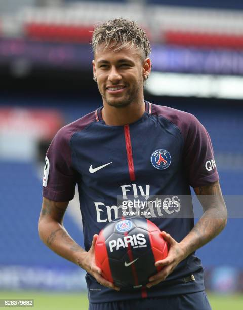 Neymar of Paris SaintGermain pose during his presentation to the press at Parc des Princes on August 4 2017 in Paris France