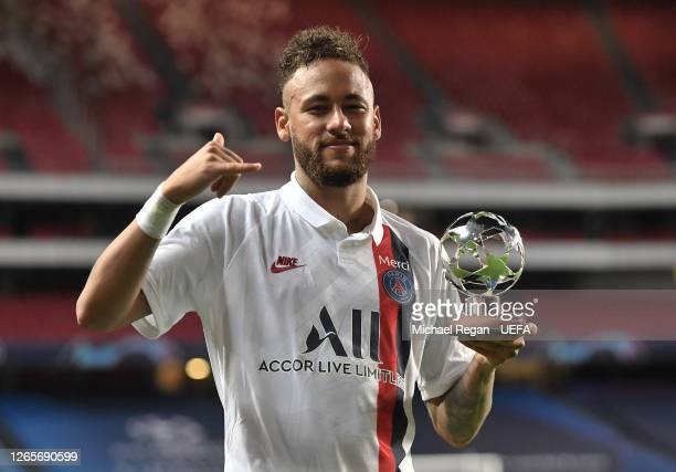 Neymar of Paris SaintGermain poses for a photo with his UEFA Champions League Man of the Match award after the UEFA Champions League Quarter Final...