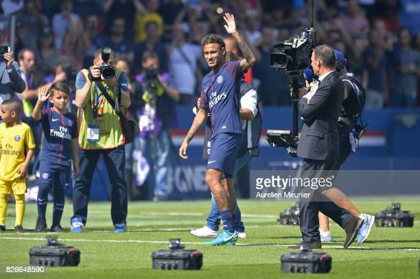 Neymar of Paris SaintGermain reacts as he is presented to the fans before the Ligue 1 match between Paris SaintGermain and Amiens at Parc des Princes...