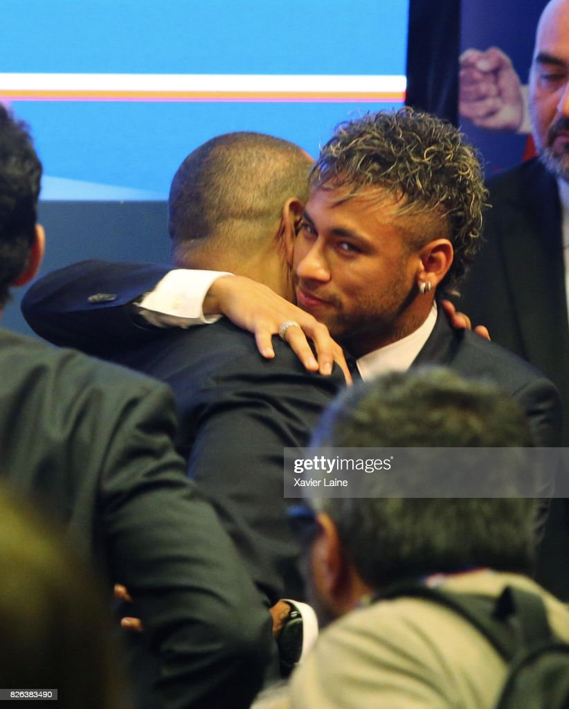 Neymar of Paris Saint-Germain (PSG) reacts with his father Neymar da Silva Sr. after the press conference at Parc des Princes on August 4, 2017 in Paris, France.