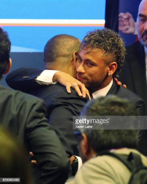 Neymar of Paris SaintGermain reacts with his father Neymar da Silva Sr after the press conference at Parc des Princes on August 4 2017 in Paris France