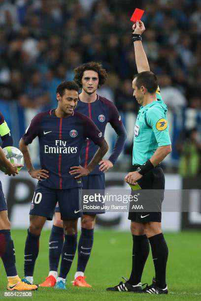 Neymar of Paris Saint-Germain receives a red card during the Ligue 1 match between Olympique Marseille and Paris Saint Germain at Stade Velodrome on...