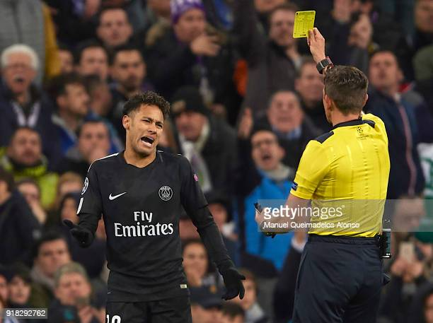 Neymar of Paris SaintGermain receives a yellow card from referee Gianluca Rocchi during the UEFA Champions League Round of 16 First Leg match between...