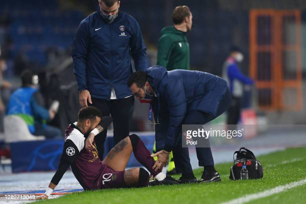 Neymar of Paris SaintGermain receives medical treatment during the UEFA Champions League Group H stage match between Istanbul Basaksehir and Paris...