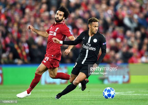 Neymar of Paris SaintGermain runs with the ball under pressure from Mohamed Salah of Liverpool during the Group C match of the UEFA Champions League...