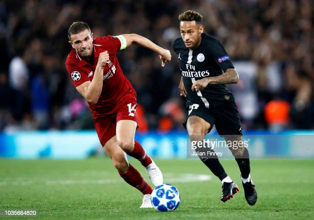 Neymar of Paris SaintGermain runs with the ball under pressure from Jordan Henderson of Liverpool during the Group C match of the UEFA Champions...