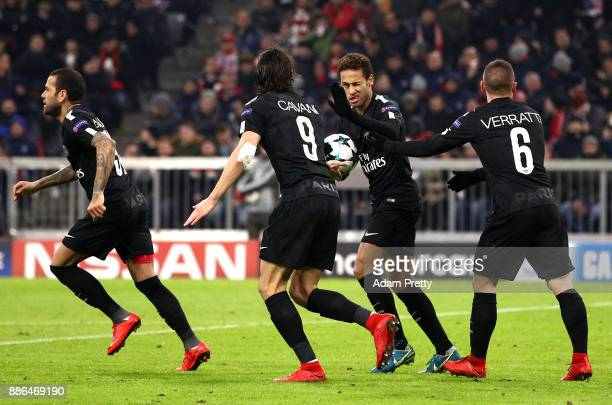 Neymar of PSG celebrates his sides second goal with Edinson Cavani of PSG during the UEFA Champions League group B match between Bayern Muenchen and...
