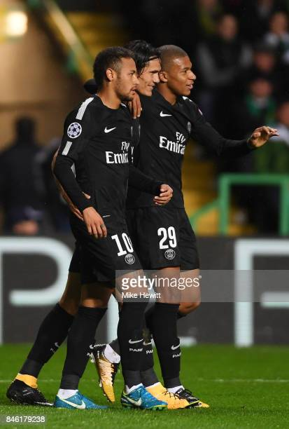 Neymar of PSG celebrates scoring his sides first goal with Edinson Cavani of PSG and Kylian Mbappe of PSG during the UEFA Champions League Group B...