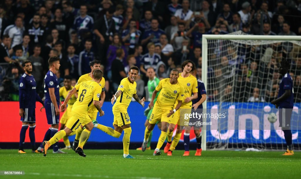 Neymar of PSG celebrates scoring his sides third goal with his PSG team mates during the UEFA Champions League group B match between RSC Anderlecht and Paris Saint-Germain at Constant Vanden Stock Stadium on October 18, 2017 in Brussels, Belgium.